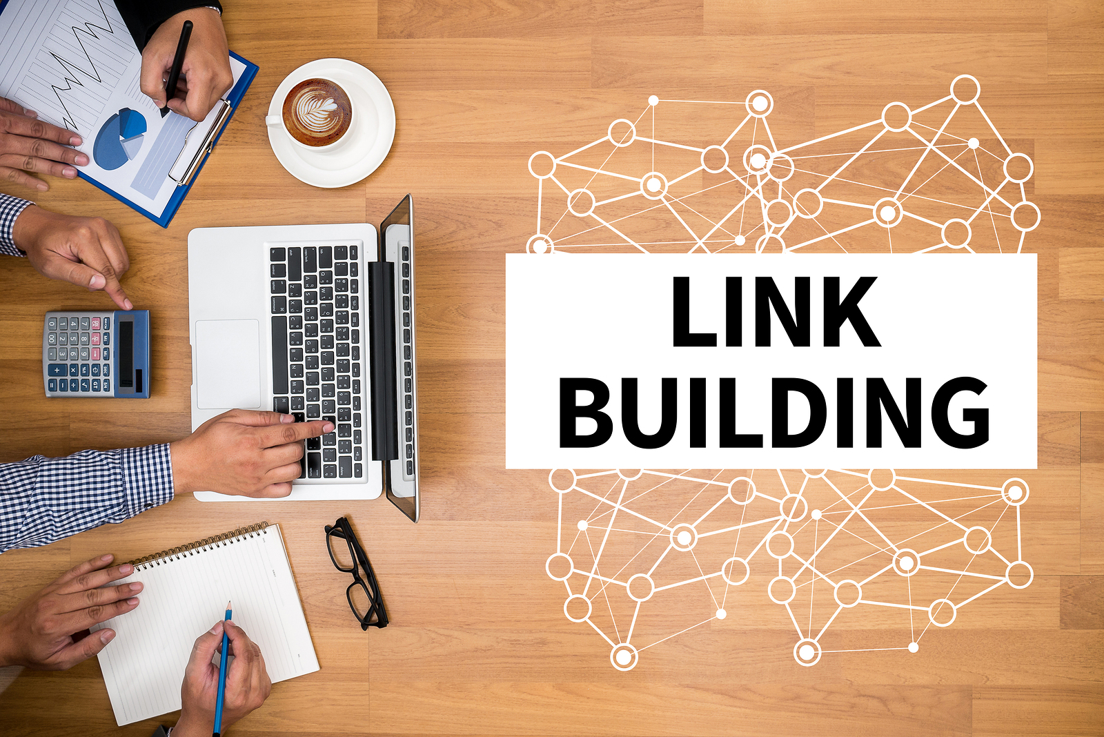 LINK BUILDING Business team hands at work with financial reports and a laptop